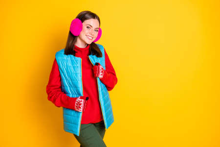 Photo of attractive girl touch mittens her vest enjoy winter holiday rest relax wear pants isolated over shine color background