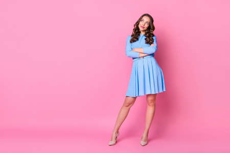 Full length body size view of nice-looking attractive lovely minded creative cheery wavy-haired lady folded arms creating plan copy space isolated over pink pastel color background