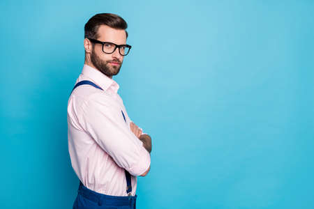 Profile photo of handsome business man arms crossed successful young chief boss not smiling worker wear specs pink shirt suspenders pants isolated pastel blue color background