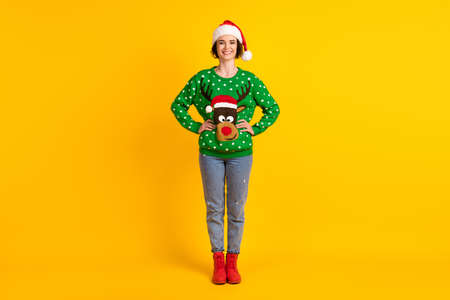 Full size photo of positive girl enjoy x-mas christmas newyear jolly theme party put hands waist wear reindeer decor pullover santa hat isolated bright shine color background 版權商用圖片