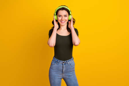 Portrait of her she nice attractive lovely pretty cute cheerful cheery wavy-haired girl listening favorite music isolated on bright vivid shine vibrant yellow color background