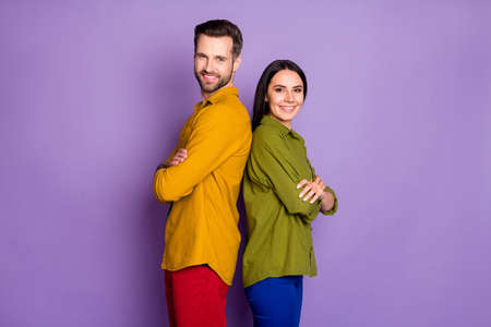 Profile photo cool lady handsome guy stand back-to-back arms crossed confident partners team toothy smiling wear casual shirts pants outfit isolated purple color background