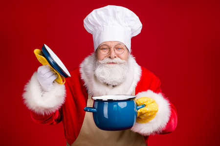 Close up photo of white grey hair bearded santa claus open pot cover saucepan smell x-mas dinner wear chef cap apron isolated bright shine color background