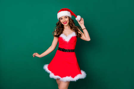 Photo of pretty charming stunning fancy girl in santa claus headwear enjoy x-mas jolly holly magic fairy event wear skirt black belt isolated over green color background