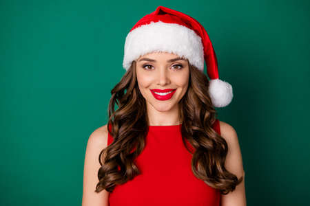 Close up photo of lovely charming magnificent girl in santa claus headwear look good in camera enjoy x-mas fairy holly event wear skirt isolated over green color background