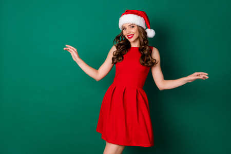 Photo of magnificent charming chic lady girl enjoy x-mas magic miracle event wear good look santa claus outfit headwear isolated over green color background