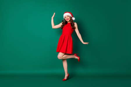 Full size photo positive dreamy stunning classy girl in santa claus headwear enjoy x-mas fairy magic newyear event wear skirt high-heels stilettos isolated green color background