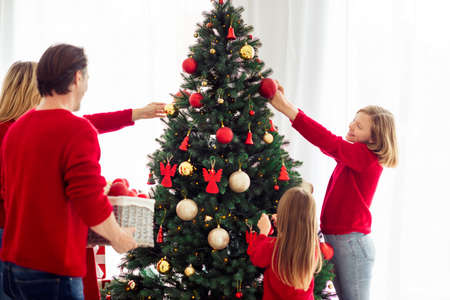 Portrait of nice adorable friendly attractive big full cheerful family small little kids decorating tree spending day Eve Noel holly jolly in light white apartment house indoor