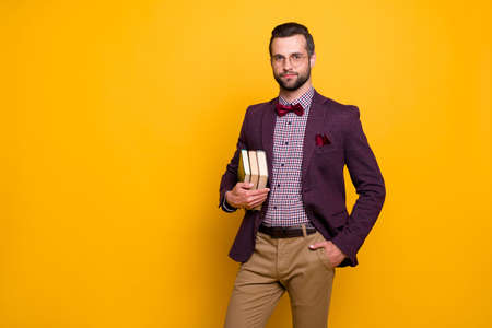 Photo of handsome rich clothes look outfit guy student hold many books university college young professor wear specs plaid shirt blazer isolated yellow color background