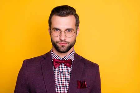 Closeup photo of handsome rich clothes stylish guy boyfriend business man party look well-dressed wear specs tie bow plaid shirt blazer isolated yellow vibrant vivid color background