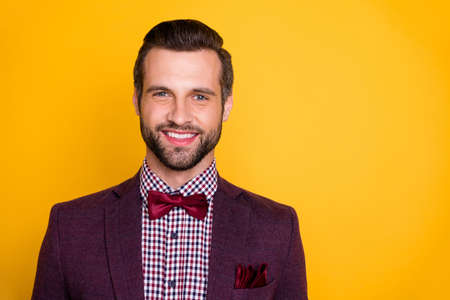 Close-up portrait of his he nice attractive unshaven cheerful cheery guy showman wearing vintage tux checked shirt isolated over bright vivid shine vibrant yellow color background Reklamní fotografie