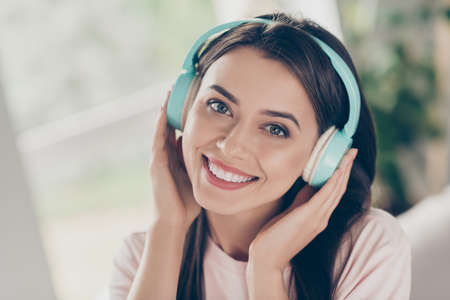 Close-up portrait of her she nice attractive pretty charming lovely cute sweet cheerful peaceful brown-haired girl fan enjoying listening radio hit pop genre staying home apartment Stock fotó