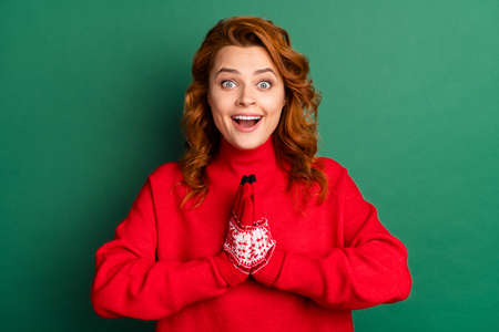 Photo of excited surprised lady hold hands open mouth wear red mittens sweater isolated green color background