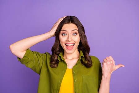 Close-up portrait of her she nice attractive lovely cheerful cheery glad brown-haired girl demonstrating new novelty ad isolated over bright vivid shine vibrant lilac violet purple color background