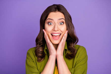 Portrait of astonished crazy funky girl hear incredible black friday bargain news impressed shout touch hands face wear good look clothes isolated over violet color background 版權商用圖片 - 157607640