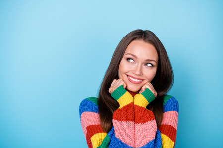 Close-up portrait of her she nice attractive cheerful cheery curious creative girl thinking creating strategy copy space isolated bright vivid shine vibrant blue color background