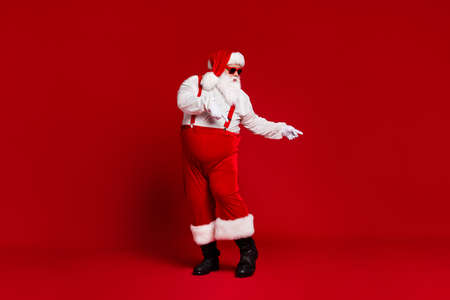 Full length body size view of his he attractive cool funny fat white-haired Santa dancing having fun chill rest relax isolated bright vivid shine vibrant red burgundy maroon color background 版權商用圖片