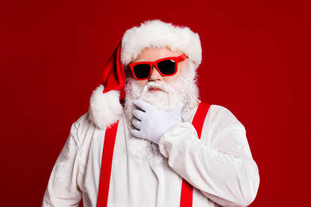 Close-up portrait of his he attractive confident naughty arrogant white-haired Santa father touching beard thinking isolated over bright vivid shine vibrant red burgundy maroon color background