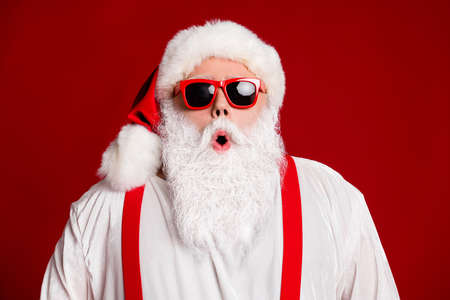 Close-up portrait of his he attractive amazed stunned wondered cheery Santa father pout lips wow reaction isolated over bright vivid shine vibrant red burgundy maroon color background