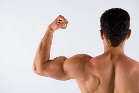 Close-up cropped rear back beind view of his he nice attractive powerful successful professional sportive guy trainer coach showing muscles motivation isolated over light white pastel color background