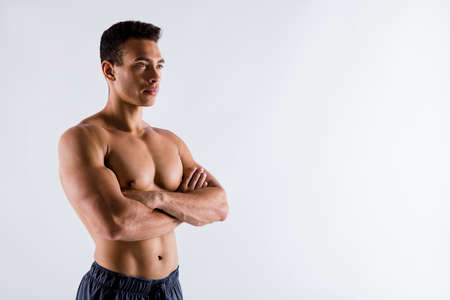 Profile side view portrait of his he nice attractive powerful strong content tanned guy ripped shape figure world champion folded arms isolated on light white pastel color background 免版税图像 - 157878927