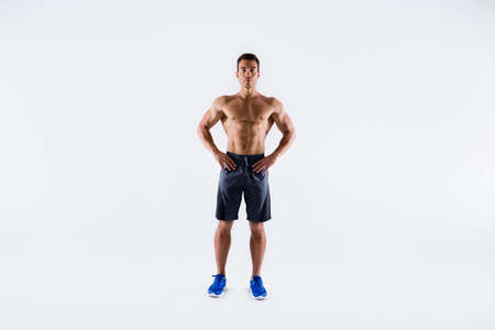 Full length body size view of his he nice attractive serious content sportive tanned tall guy ripped shape figure professional fighter competitor posing isolated on light white pastel color background