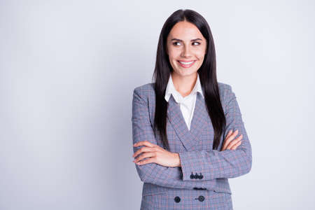 Photo of experienced skilled professional lady arms crossed corporate stuff conference good mood look interested empty space have creative idea formalwear isolated grey color background