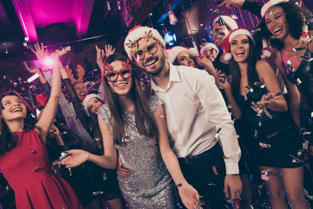 Photo of positive people man embrace charming girl toothy smile camera deer x-mas glasses modern club indoors