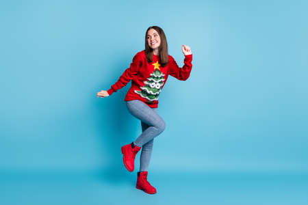 Full body photo of girl dance x-mas event wear christmas tree decor comfort sweater jumper boots isolated over blue pastel color background
