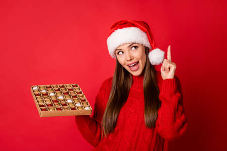 Close-up portrait of her she nice attractive charming cheerful creative girl holding in hands choosing tree balls box newyear occasion isolated over bright vivid shine vibrant red color background Stock fotó