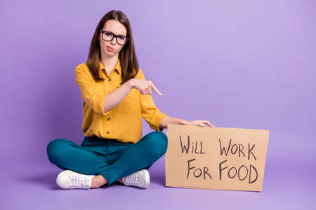 Photo portrait of girl pointing with finger at carton placard will work for food isolated on bright purple color background