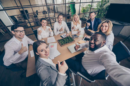 Professional managers have company growth plan training conference make selfie approve way-out crisis cost recession solution show thumbup sign sit table desk in boardroom workstation