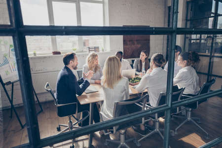 Nice attractive focused stylish experienced executive managers collaborators gathering listening ceo boss chief marketing industry department at loft industrial style interior workplace workstation