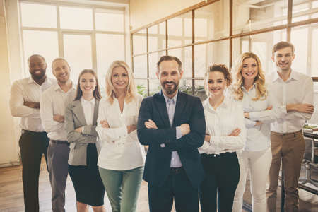 Photo of business man lady people eight diversity partners big office successful professionals good mood hr agents team stand arms crossed self-confident specialists indoors