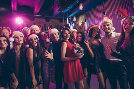 Photo portrait of people posing at party holding disco ball Standard-Bild