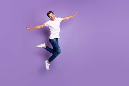 Full length body size view of his he nice attractive funky cheerful cheery guy jumping having fun free time vacation isolated on bright vivid shine vibrant violet lilac purple color background Stock fotó