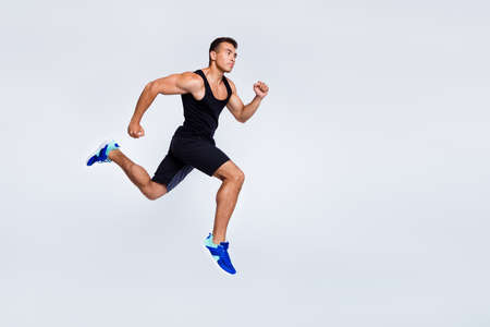 Full length body size view of his he nice attractive muscular sportive strong purposeful guy jumping running jogging distance isolated over light gray pastel color background