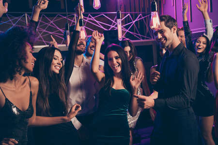 Photo portrait of cute couple dancing together at nightclub with many people congratulating birthday girl