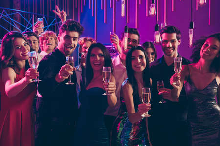 Cheers Photo portrait of people holding champagne glasses to camera greeting together each other holding glasses Stok Fotoğraf