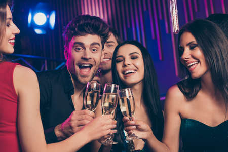 Photo portrait of students clinking champagne glasses at party saying good words to birthday boy