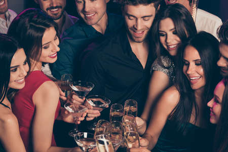 Photo portrait of group of people clinking champagne glasses having fun time together