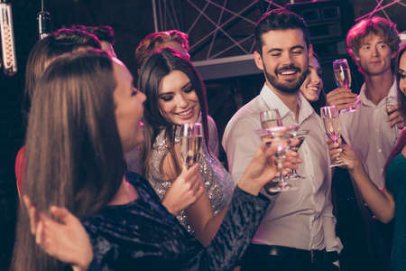 Photo portrait of people dancing together clinking champagne glasses sating greetings Stok Fotoğraf