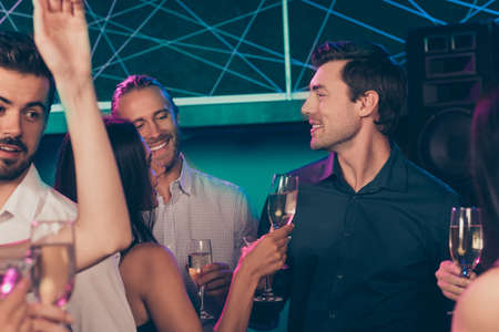 Photo portrait of two guys and girl drinking champagne together at nightclub Stok Fotoğraf