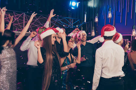 Photo portrait of crazy young people together dancing wearing christmas headwear celebrating new year at nightclub