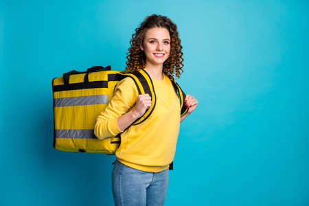 Portrait of her she nice attractive pretty content cheerful cheery wavy-haired girl carrying takeout meal lunch big bag isolated over bright vivid shine vibrant blue color background