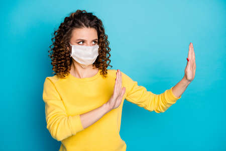 Portrait of her she nice attractive conscious serious wavy-haired girl wearing safe mask showing veto protest against sars ncov-2 isolated over bright vivid shine vibrant blue color background