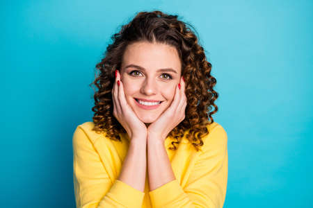 Close-up portrait of her she nice-looking attractive winsome cute pretty cheerful cheery wavy-haired girl enjoying spring beauty skin care isolated on bright vivid shine vibrant blue color background