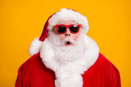 Close-up portrait of his he nice attractive amazed Santa father newyear celebration party December festival pout lips isolated over bright vivid shine vibrant yellow color background