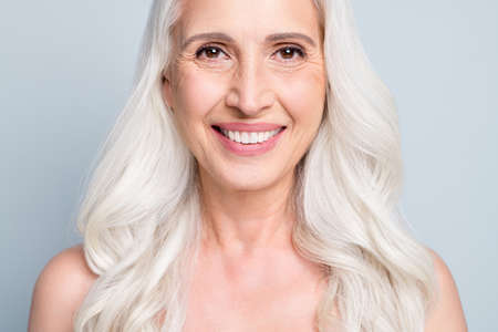 Cropped close-up view portrait of her she attractive cheerful grey-haired lady healthy teeth beaming smile isolated on gray pastel color background