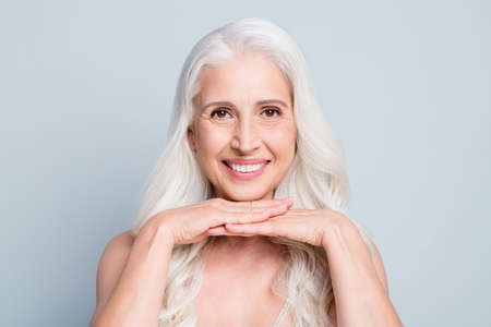 Close-up portrait of her she nice attractive cheery grey-haired elderly lady pure soft skin therapy isolated on light gray pastel color background